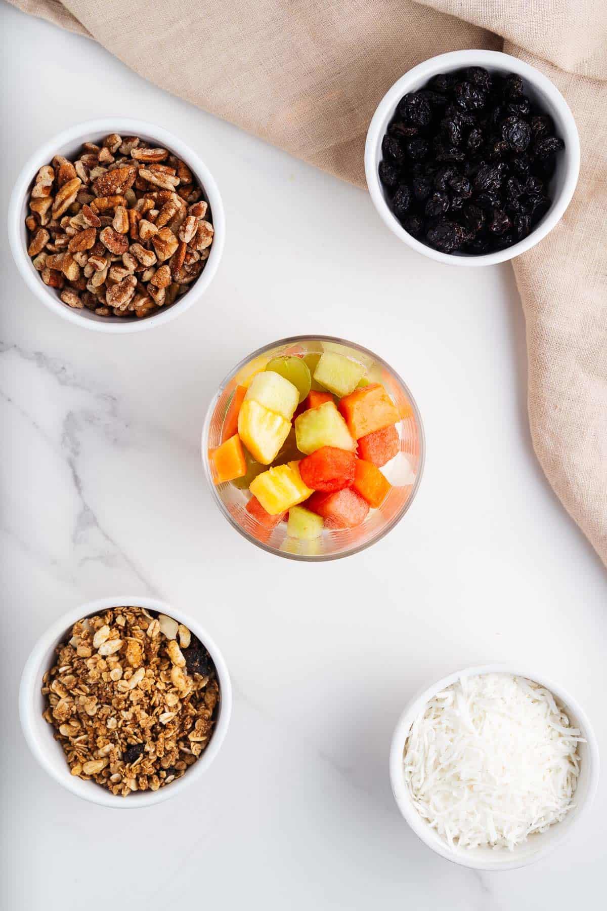 Bionicos Cup, Granola, Coconut Shreds, Raisins, and Pecans
