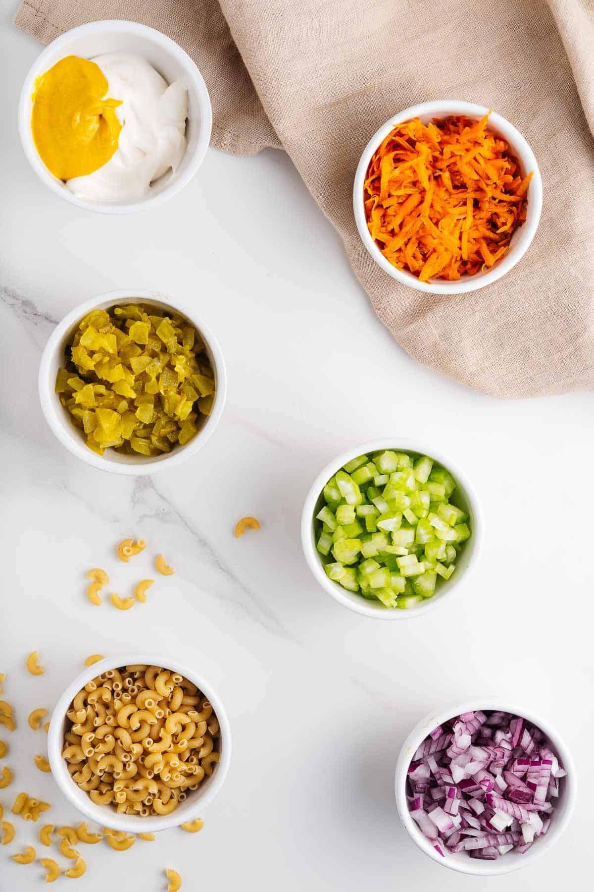 Vegan Mayo, Mustard, Crema, Pickles, Carrots, Red Onion, Celery, and Macaroni