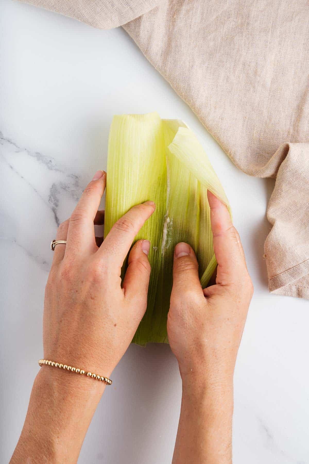 Hands Folding a Tamal de Elote