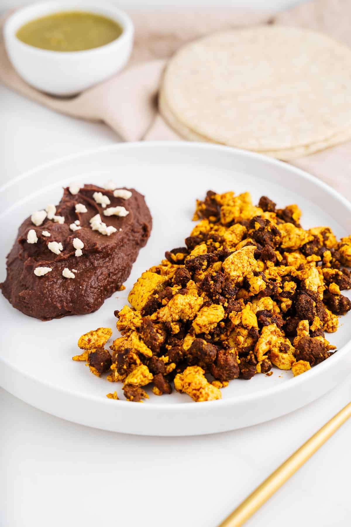 Vegan Huevos con Chorizo and Refried Beans on a Plate