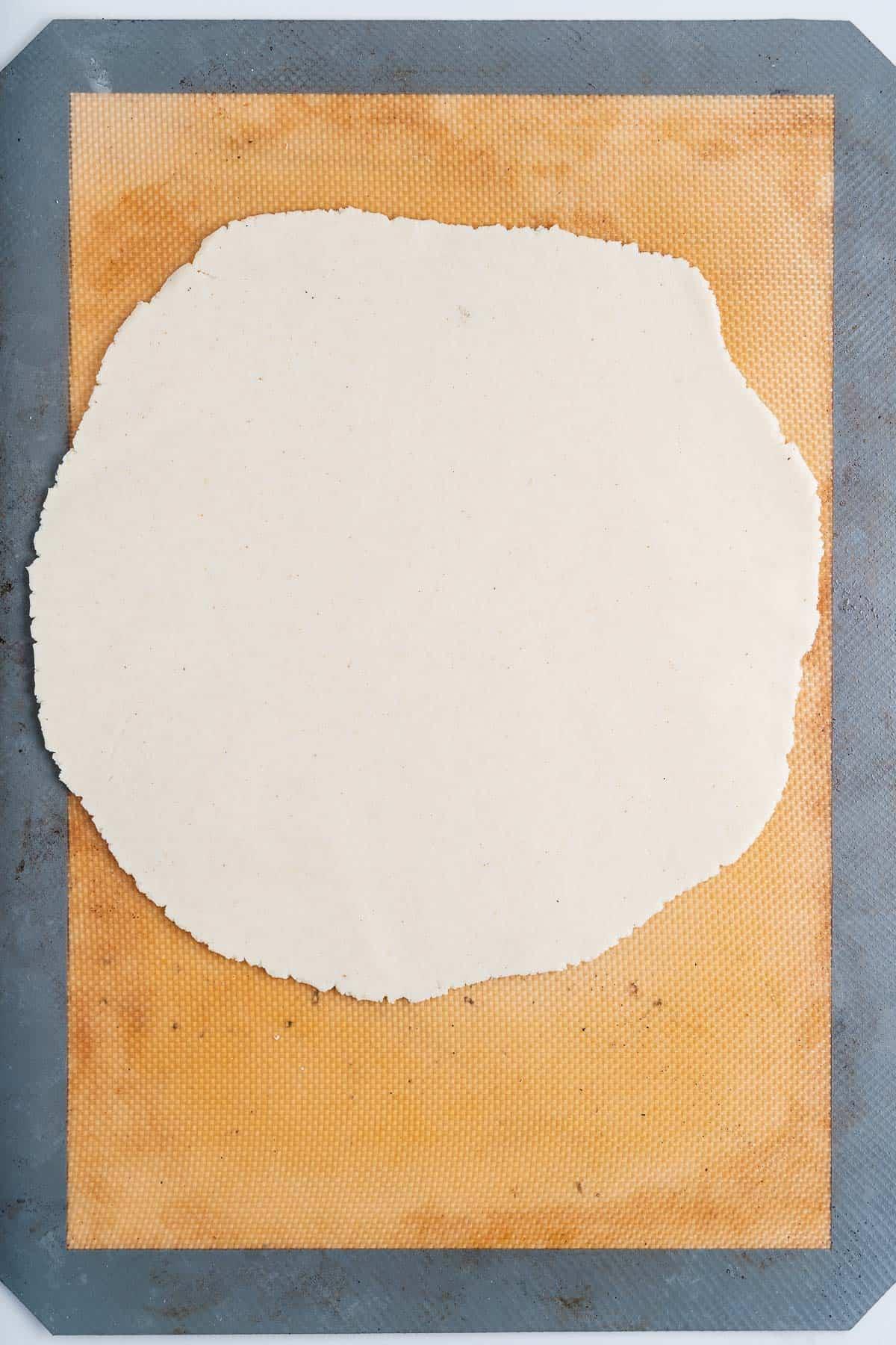 Raw Corn Tortilla on a Baking Mat